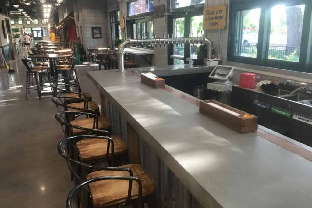 large concrete bartop in brewery