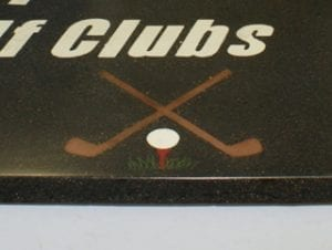 closeup of concrete countertop with golf logo embedded