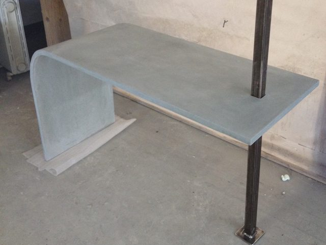 curved concrete table with steel beam by Zen Stoneworks