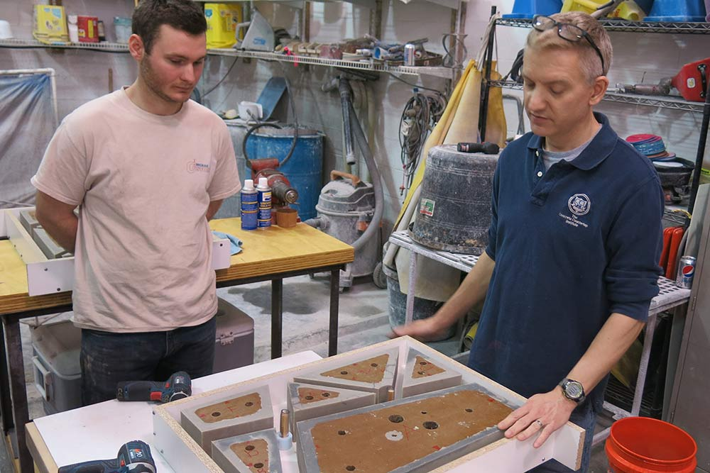 Justin McRae and Jeff Girard with rubber concrete mold