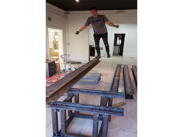 assembling steel support for cantilevered concrete table