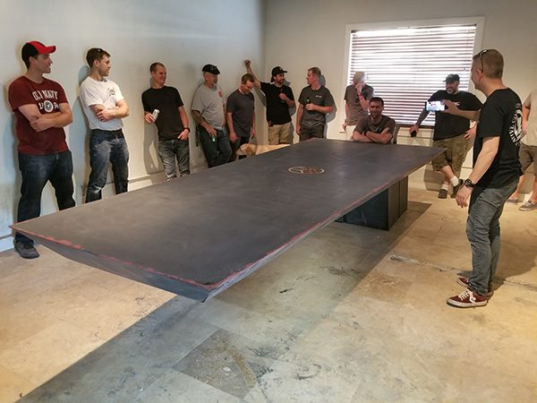 sitting at end of 11 foot cantilevered concrete table