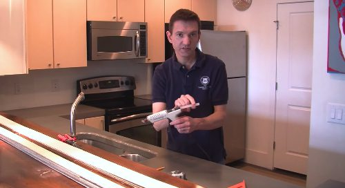 A hot glue gun to adhere the template to the existing concrete countertops