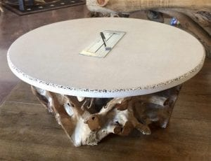 round white concrete coffee table with driftwood base